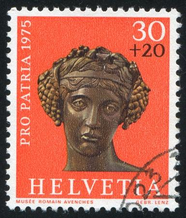 bacchus: SWITZERLAND - CIRCA 1975: stamp printed by Switzerland, shows Bronze head of Bacchus,  circa 1975 Editorial