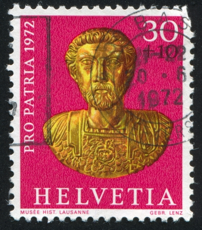 SWITZERLAND - CIRCA 1972: stamp printed by Switzerland, shows Gold bust of Emperor Marcus Aurelius, Roman period, circa 1972