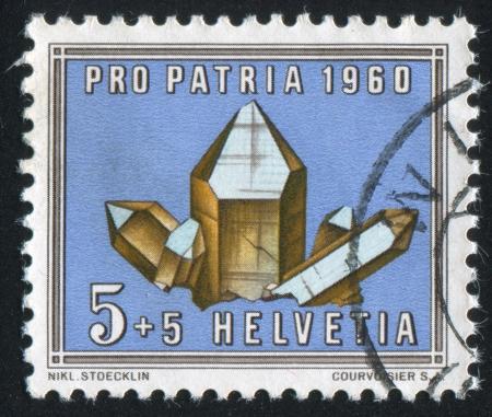 SWITZERLAND - CIRCA 1960: stamp printed by Switzerland, shows Smoky quz, circa 1960 Stock Photo - 18114465
