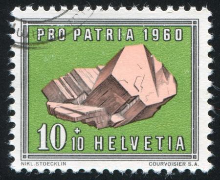 SWITZERLAND - CIRCA 1960: stamp printed by Switzerland, shows Feldspar, circa 1960 Stock Photo - 18114471