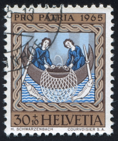 SWITZERLAND - CIRCA 1965: stamp printed by Switzerland, shows Fishermen on Sea of Galilee, circa 1965