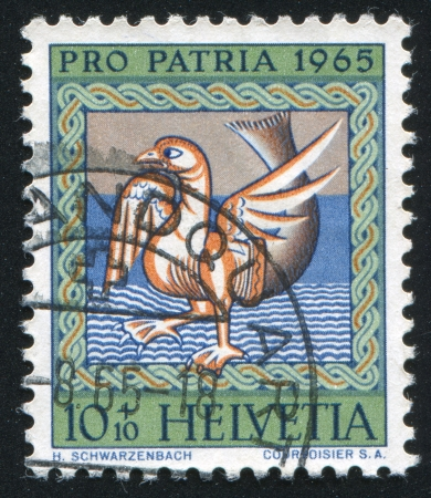 confluence: SWITZERLAND - CIRCA 1965: stamp printed by Switzerland, shows Symbol of evil (goose with fishtail), circa 1965 Editorial