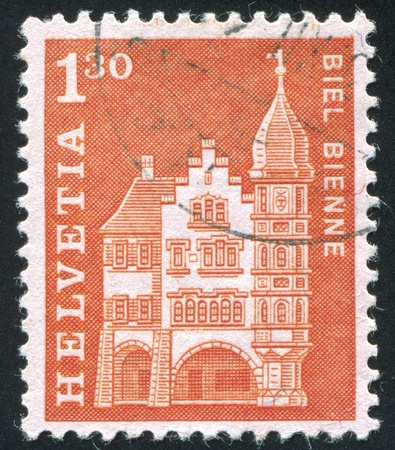 guildhall: SWITZERLAND - CIRCA 1963: stamp printed by Switzerland, shows Woodcutters Guildhall, Biel, circa 1963