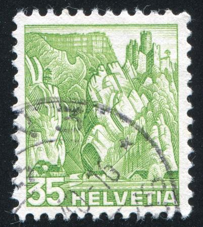 castles needle: SWITZERLAND - CIRCA 1936: stamp printed by Switzerland, shows Balsthal Pass, circa 1936