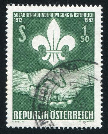 handbreadth: AUSTRIA - CIRCA 1962: stamp printed by Austria, shows Scout emblem and handshake, circa 1962