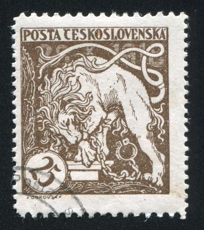 CZECHOSLOVAKIA - CIRCA 1919: stamp printed by Czechoslovakia, shows Bohemian Lion Breaking its Chains, circa 1919 Stock Photo - 18329708