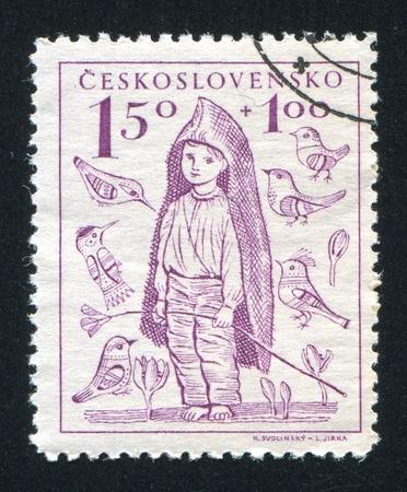 piedi nudi ragazzo: Cecoslovacchia - CIRCA 1948: timbro stampato dalla Cecoslovacchia, mostra Barefoot Boy, circa 1948