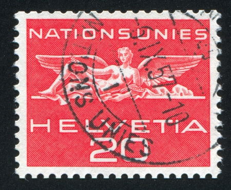SWITZERLAND - CIRCA 1962: stamp printed by Switzerland, shows Statue from UN building in Geneva, circa 1962 Stock Photo - 18329762
