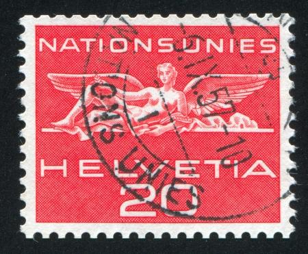 SWITZERLAND - CIRCA 1962: stamp printed by Switzerland, shows Statue from UN building in Geneva, circa 1962 Stock Photo - 18329762