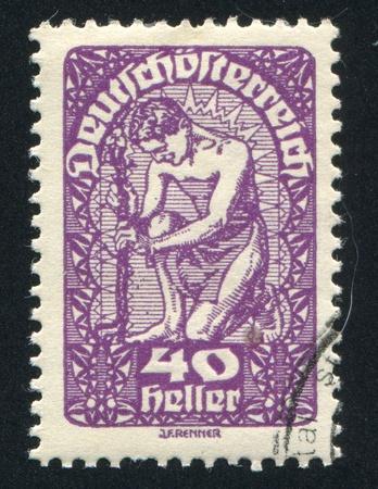 AUSTRIA - CIRCA 1919: stamp printed by Austria, shows Man and flower, circa 1919 Stock Photo - 18777770