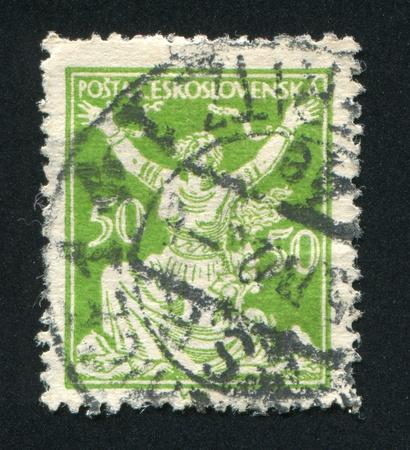 czechoslovakia: CZECHOSLOVAKIA - CIRCA 1920: stamp printed by Czechoslovakia, shows Czechoslovakia Breaking Chains to Freedom, circa 1920