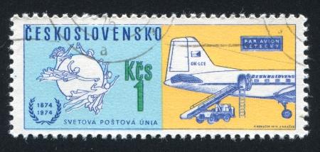 czechoslovak: CZECHOSLOVAKIA - CIRCA 1974: stamp printed by Czechoslovakia, shows Universal Postal Union Emblem and Czechoslovak Airlines mail plane, circa 1974