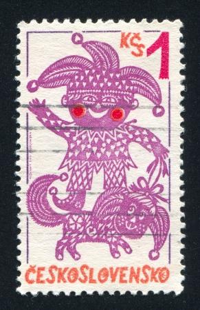 caftan: CZECHOSLOVAKIA - CIRCA 1980: stamp printed by Czechoslovakia, shows Punch and dog, circa 1980