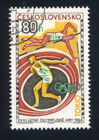 CZECHOSLOVAKIA - CIRCA 1964: stamp printed by Czechoslovakia, shows Discus Thrower and Pole Vaulter, circa 1964 Stock Photo - 18777783