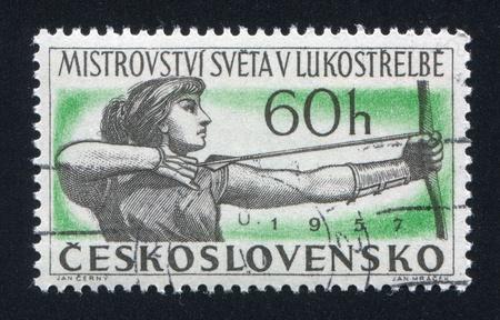 backsight: CZECHOSLOVAKIA - CIRCA 1957: stamp printed by Czechoslovakia, shows Woman Archer, circa 1957