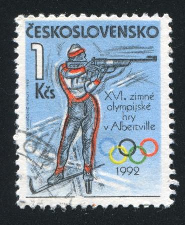 backsight: CZECHOSLOVAKIA - CIRCA 1992: stamp printed by Czechoslovakia, shows Biathlon, circa 1992