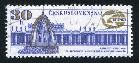 vary: CZECHOSLOVAKIA - CIRCA 1967: stamp printed by Czechoslovakia, shows Colonnade and Spring, Karlovy Vary and Communications Emblem, circa 1967 Editorial