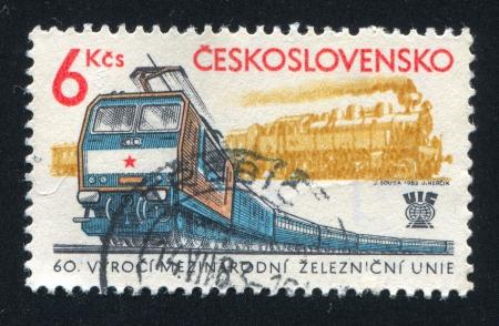 schokabsorber: CZECHOSLOVAKIA - CIRCA 1982: stamp printed by Czechoslovakia, shows Steam and electric locomotives, circa 1982 Editorial