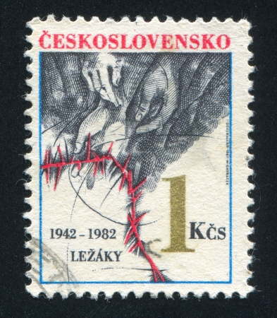 broaching: CZECHOSLOVAKIA - CIRCA 1982: stamp printed by Czechoslovakia, shows Hands, barbed wire, circa 1982