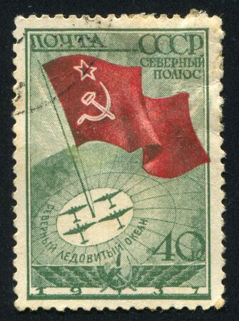 soviet flag: RUSSIA - CIRCA 1938: stamp printed by Russia, shows Soviet Flag and Airplanes at North Pole, circa 1938