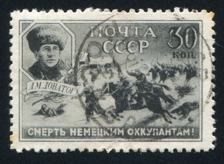 major battle: RUSSIA - CIRCA 1942: stamp printed by Russia, shows Major General Dovator and Cossack Cavalry in Action, circa 1942 Editorial