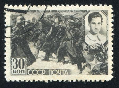 RUSSIA - CIRCA 1942: stamp printed by Russia, shows Zoya Kosmodemjanskaja and nazi soldiers, circa 1942