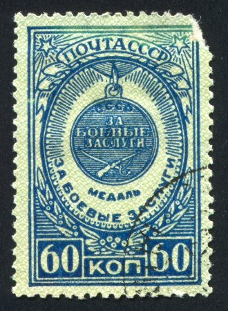 RUSSIA - CIRCA 1946: stamp printed by Russia, shows Meritorious services in battle medal, circa 1946