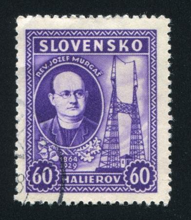 telegraphy: SLOVENIA - CIRCA 1939: timbro stampato dalla Slovenia, mostra Rev. Josef Murgas e Radio Towers, circa 1939 Editoriali