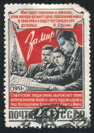 RUSSIA - CIRCA 1951: stamp printed by Russia, shows Flag and citizens signing peace appeal, circa 1951 Stock Photo - 18900321