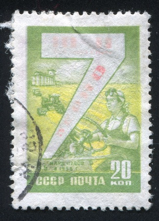 RUSSIA - CIRCA 1959: stamp printed by Russia, shows Grain production and woman tractor driver, circa 1959