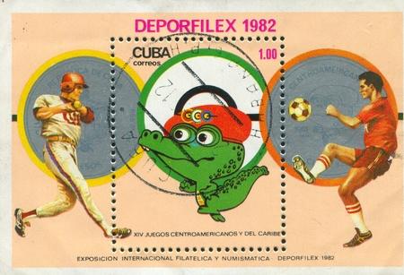 ballplayer: CUBA - CIRCA 1982: stamp printed by Cuba, shows Ballplayer, footballer and crocodile, circa 1982 Editorial
