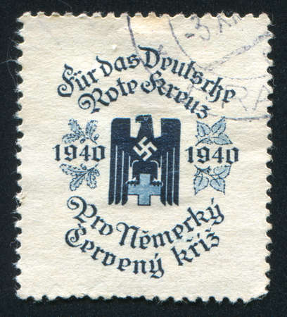 CZECHOSLOVAKIA - CIRCA 1940: stamp printed by Czechoslovakia, shows German Red Cross. This image is not a Nazi propaganda, circa 1940