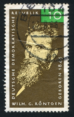 discoverer: GERMANY - CIRCA 1965: stamp printed by Germany, shows Wilhelm Conrad Roentgen, circa 1965 Editorial