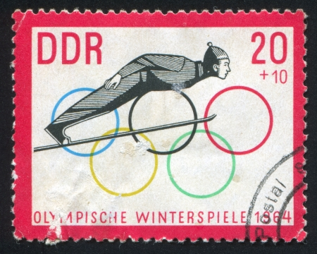 olympic rings: GERMANY - CIRCA 1963: stamp printed by Germany, shows Ski Jump and Olympic Rings, circa 1963