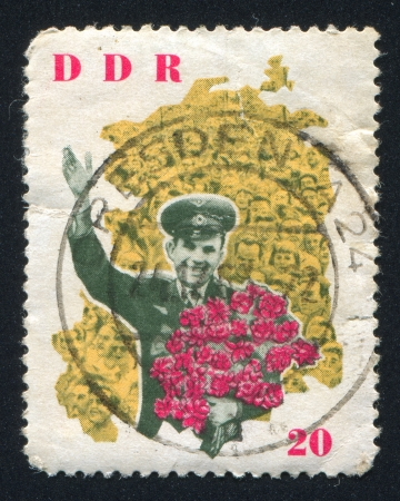 yuri: GERMANY - CIRCA 1963: stamp printed by Germany, shows  Yuri Gagarin and map of DDR, circa 1963