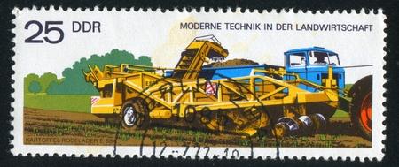 GERMANY - CIRCA 1977: stamp printed by Germany, shows Potato digger and loader, circa 1977