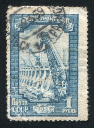 RUSSIA - CIRCA 1956: stamp printed by Russia, shows Building a dam, circa 1956