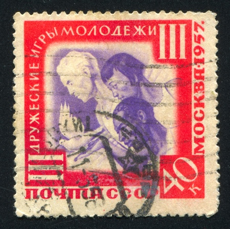 RUSSIA - CIRCA 1957: stamp printed by Russia, shows Youths of three races, circa 1957