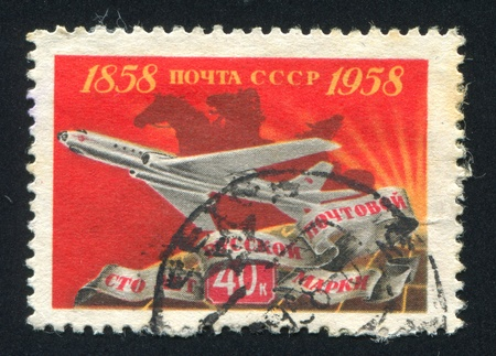 RUSSIA - CIRCA 1958: stamp printed by Russia, shows Jet plane and postilion, circa 1958
