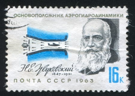 pressurized: RUSSIA - CIRCA 1963: stamp printed by Russia, shows N. E. Zhukovski, aerodynamics pioneer, and pressurized air tunnel, circa 1963 Editorial