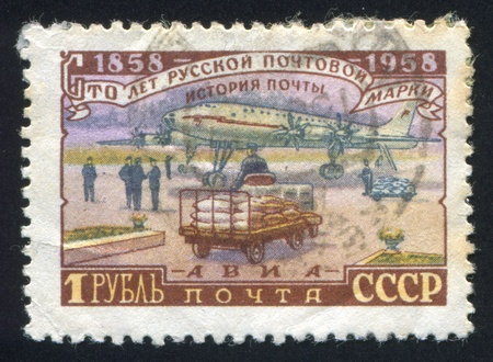 RUSSIA - CIRCA 1958: stamp printed by Russia, shows Loading mail on plane, circa 1958
