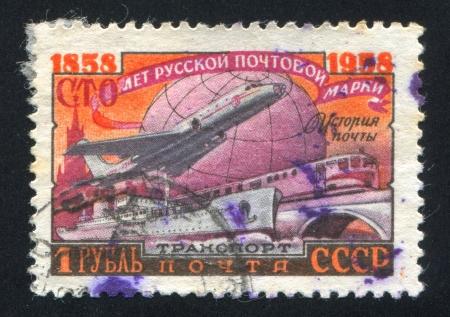 RUSSIA - CIRCA 1958: stamp printed by Russia, shows Ship, plane, train and globe, circa 1958