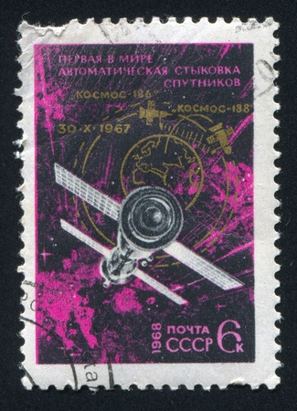 RUSSIA - CIRCA 1968: stamp printed by Russia, shows Link up of Cosmos 186 and Cosmos 188 satellites, circa 1968 Stock Photo - 19995555