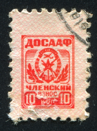 RUSSIA - CIRCA 1951: stamp printed by Russia, shows Arms of Voluntary society of assistance to the army, air force and navy, circa 1951