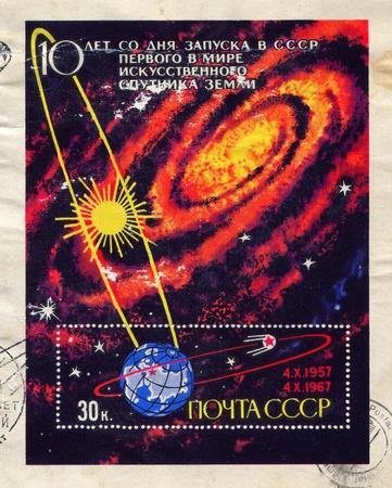 RUSSIA - CIRCA 1967: stamp printed by Russia, shows Sun, galaxy and Sputnik orbiting Earth, circa 1967