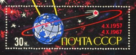 RUSSIA - CIRCA 1967: stamp printed by Russia, shows Sputnik orbiting Earth, circa 1967