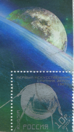 RUSSIA - CIRCA 2007: stamp printed by Russia, shows Sputnik 1 and Earth, circa 2007