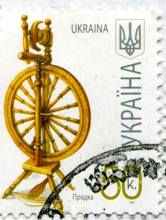 UKRAINE - CIRCA 2010: stamp printed by Ukraine, shows Spinning wheel, circa 2010
