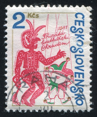 CZECHOSLOVAKIA - CIRCA 1981: stamp printed by Czechoslovakia, shows Punch and Devil, circa 1981