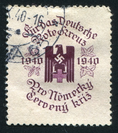 red cross red bird: CZECHOSLOVAKIA - CIRCA 1940: stamp printed by Czechoslovakia, shows German Red Cross. This image is not a Nazi propaganda, circa 1940 Editorial